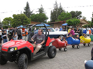 """Kids are given a free """"train ride"""" at the Car Show"""