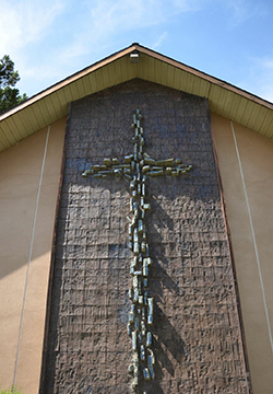 Rugged mosaic cross on the outside of our building